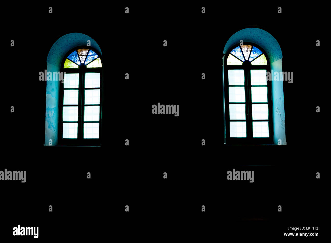 windows in the dark with colored glasses. - Stock Image
