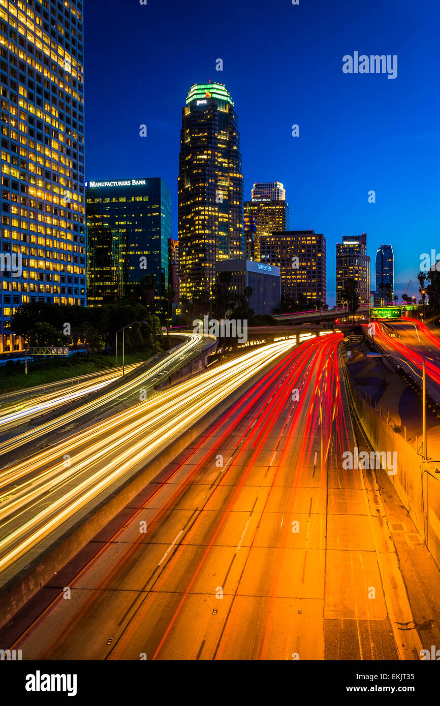 Traffic on the 110 Freeway and the Los Angeles Skyline at night, seen from the 4th Street Bridge, in downtown Los - Stock Image