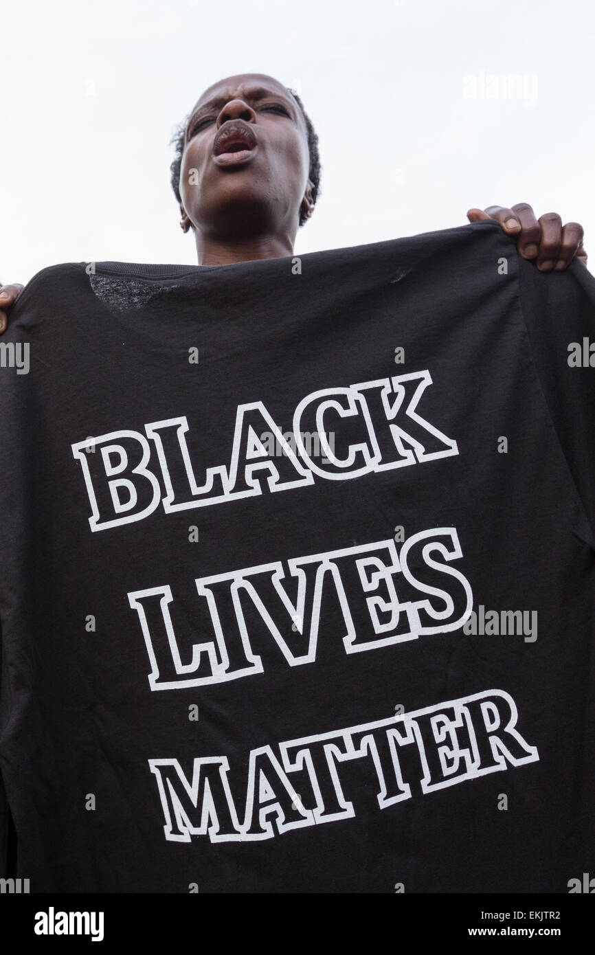 Activists hold a shirt imprinted with Black Lives Matter during a vigil outside the North Charleston City Hall following - Stock Image