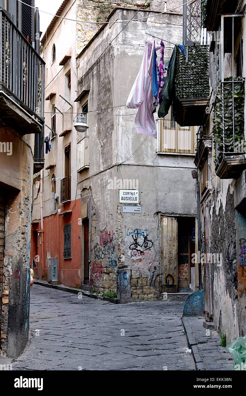 The back streets of Ercolano, Naples, Italy showing poor living conditions and graffiti - Stock Image