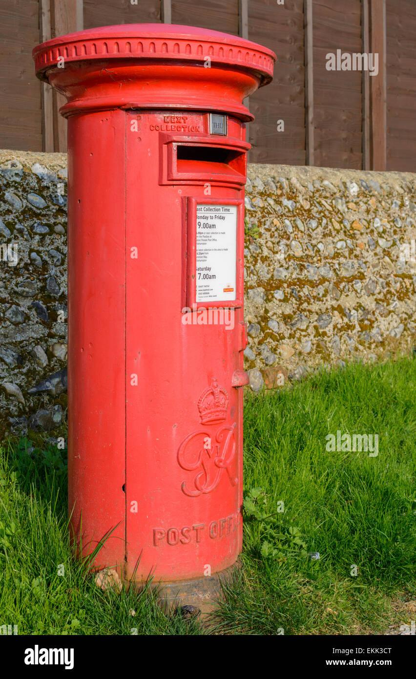 Postbox UK. Red Royal Mail pillar box in the UK. Postbox red. Letterbox red. Red letter box. Red mailbox. Mailbox - Stock Image