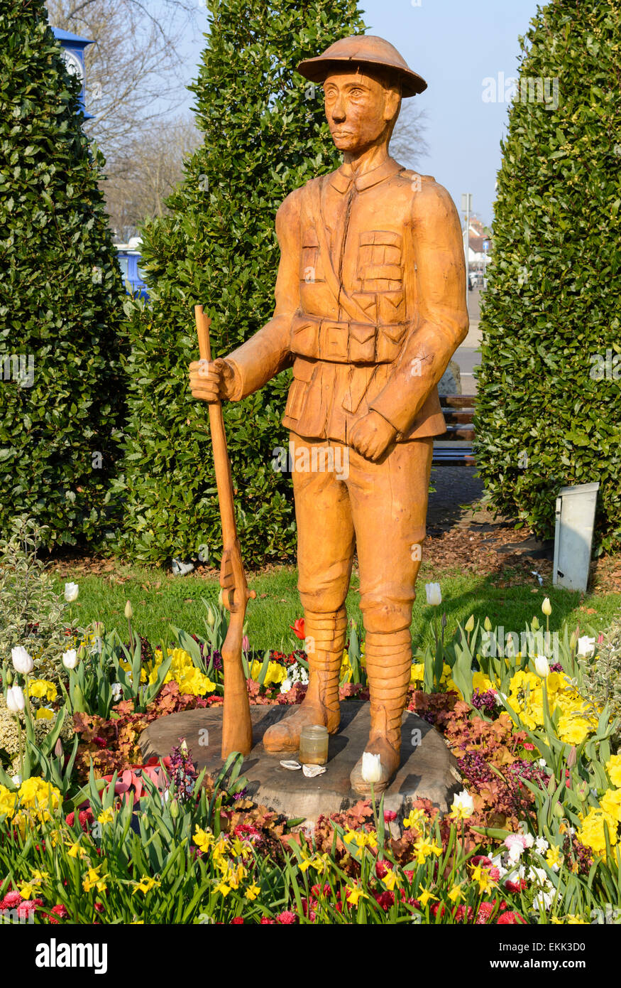 100 year WWI commemorative wooden carving of a soldier in Rustington, West Sussex, England, UK. - Stock Image