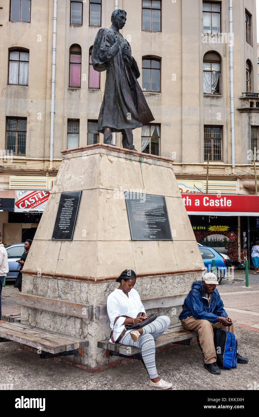 Johannesburg South Africa African Gandhi Square Mohandas Mahatma young attorney lawyer statue Black woman man residents - Stock Image