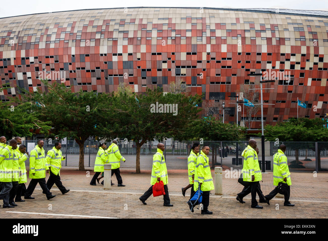 Johannesburg South Africa African Nasrec FNB Soccer City Stadium The Calabash Black man woman security guards coworkers - Stock Image