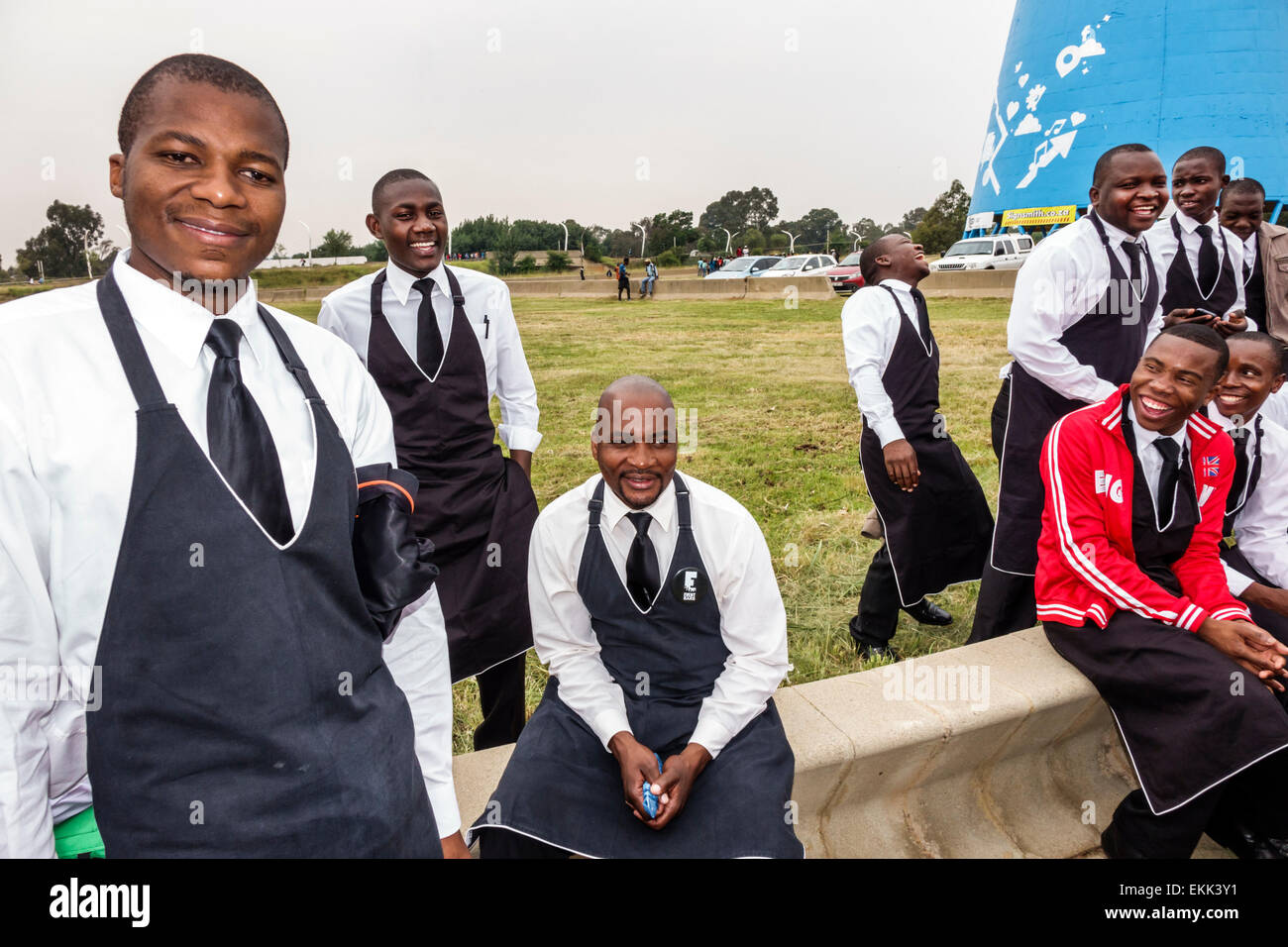Johannesburg South Africa African Nasrec FNB Soccer City Stadium The Calabash Black man coworkers uniform before - Stock Image