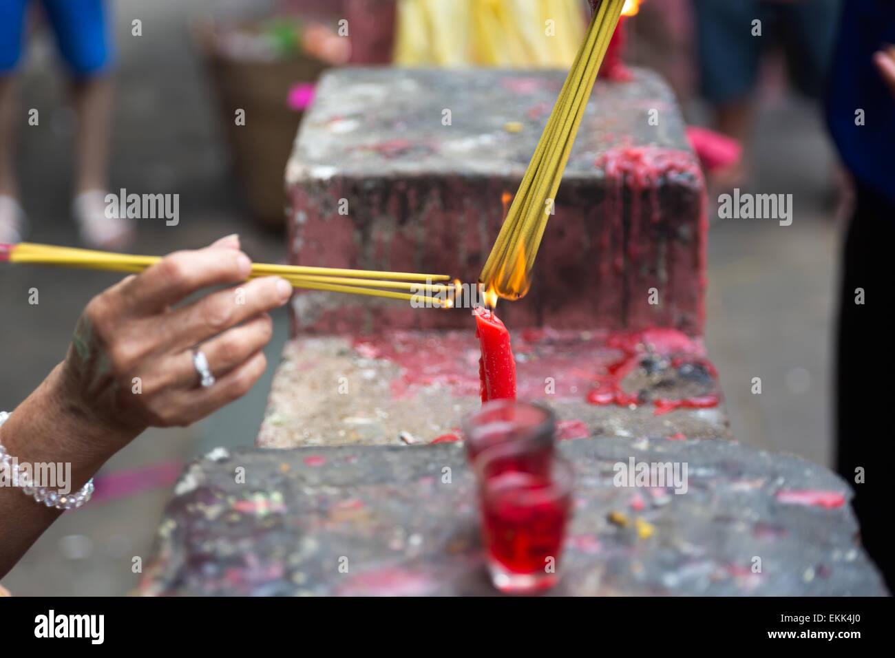 Burning joss sticks at Lunar New Year , Saigon, Vietnam Stock Photo