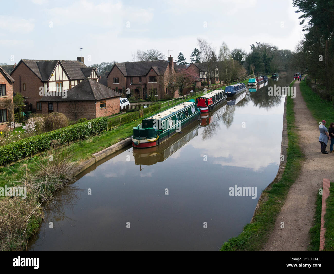 Narrowboats moored on The Shropshire Union Canal at small market town Market Drayton Shropshire towpath popular - Stock Image