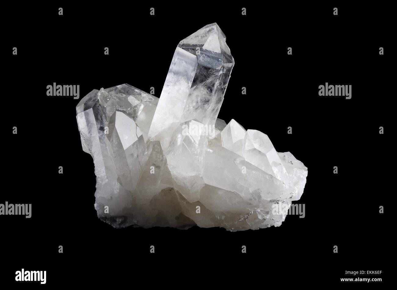 Quartz crystal cluster horizontal on black background, mineral also a semi-precious gemstone. Silica, silicon dioxide, - Stock Image