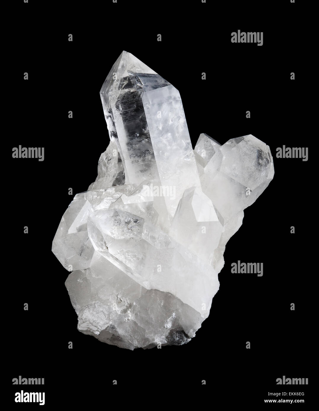 Quartz crystal cluster high size on black background, mineral also used as semi-precious gemstone. Silica, silicon - Stock Image