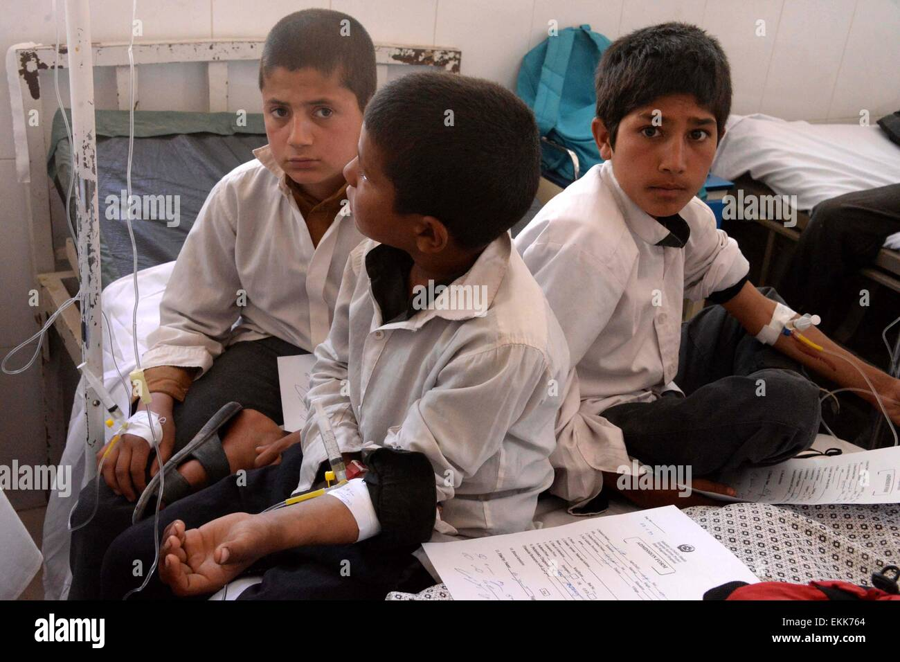 Herat, Afghanistan. 11th Apr, 2015. Afghan school students receive medical treatment after inhaling some mysterious - Stock Image