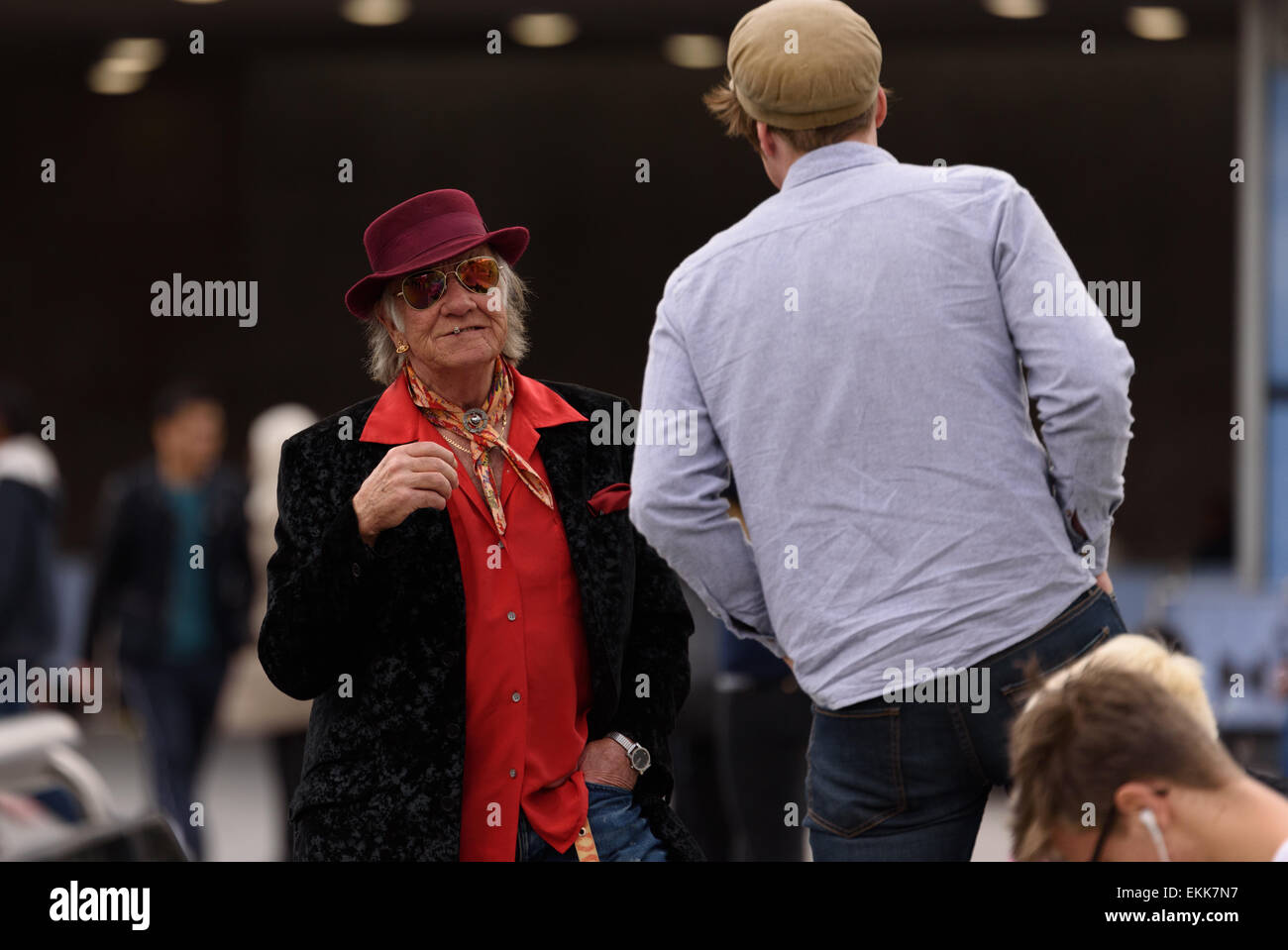 Dapper, colorful gentleman chatting and smoking in Piccadilly Gardens Manchester 11th April 2015 - Stock Image