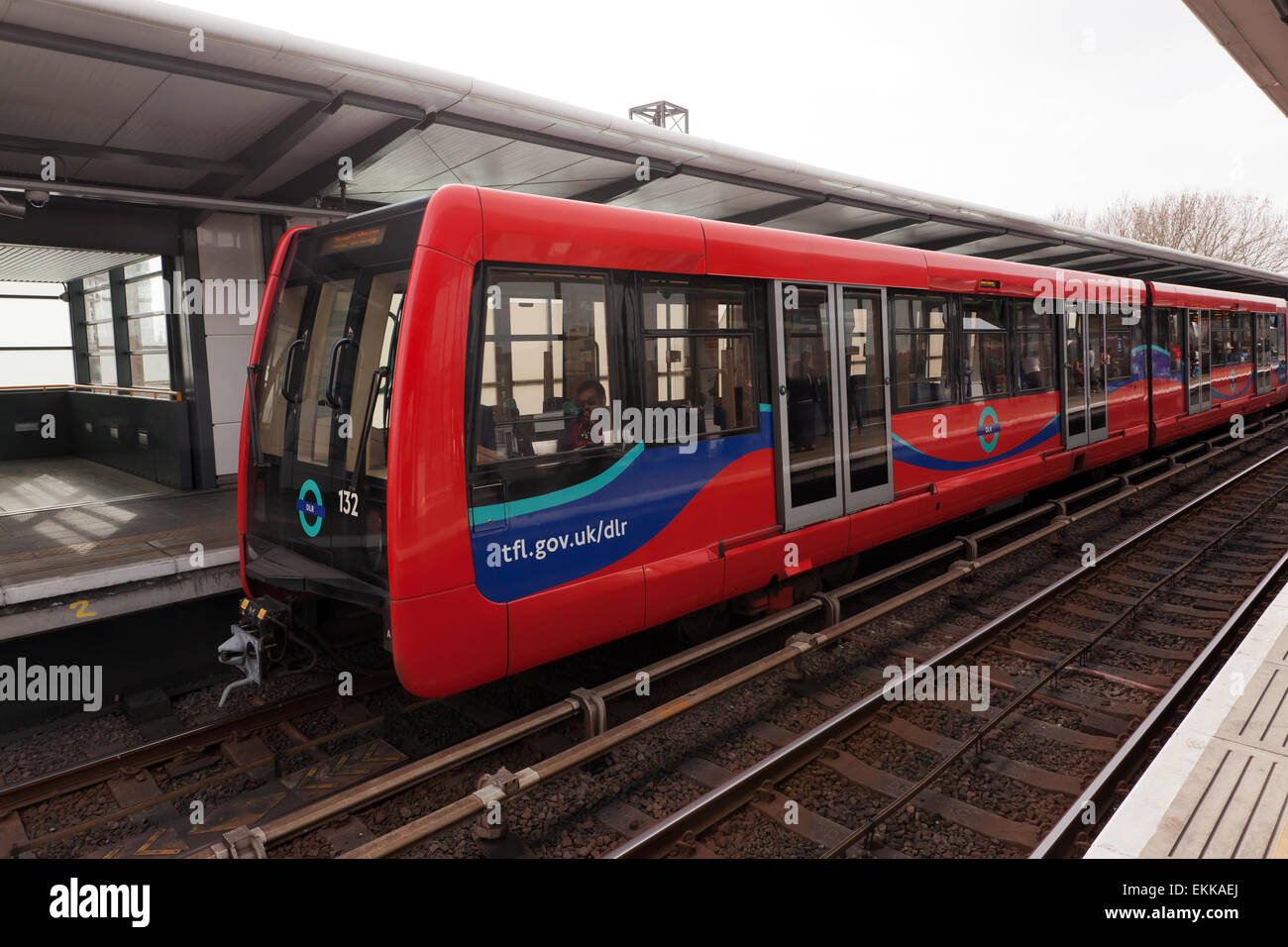 View of a Docklands Light Railway Train, as it waits at  Westferry  DLR Station. - Stock Image