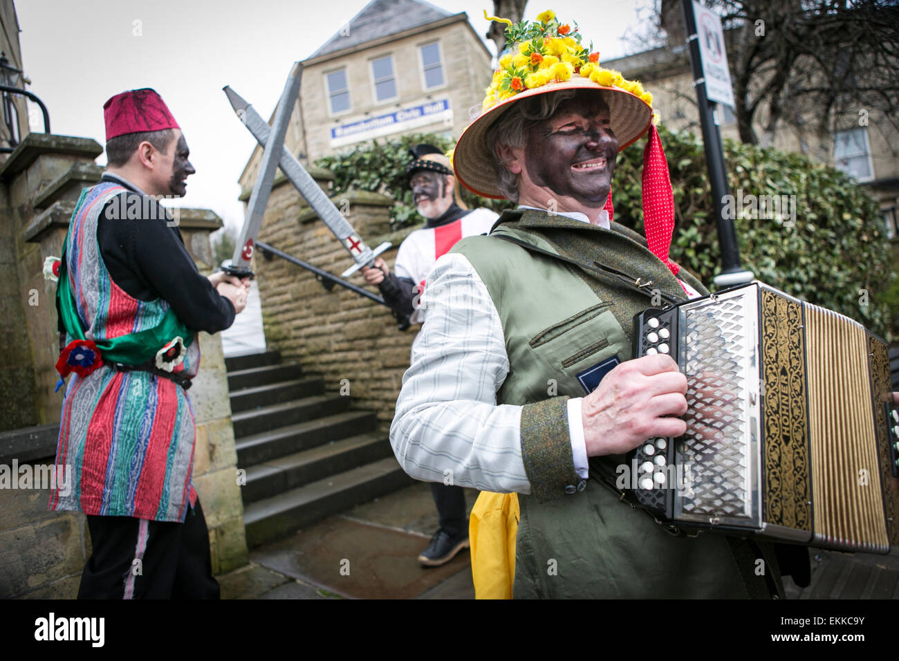 The Bury Pace Eggers perform their traditional English folk custom play in and around the pubs of Ramsbottom at - Stock Image