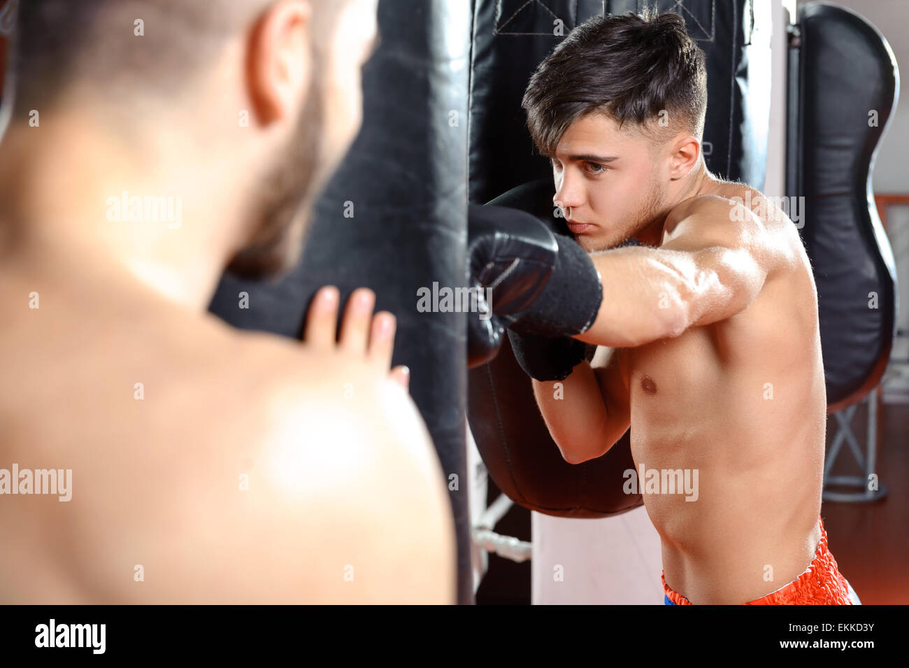Boxing coach trains his team - Stock Image