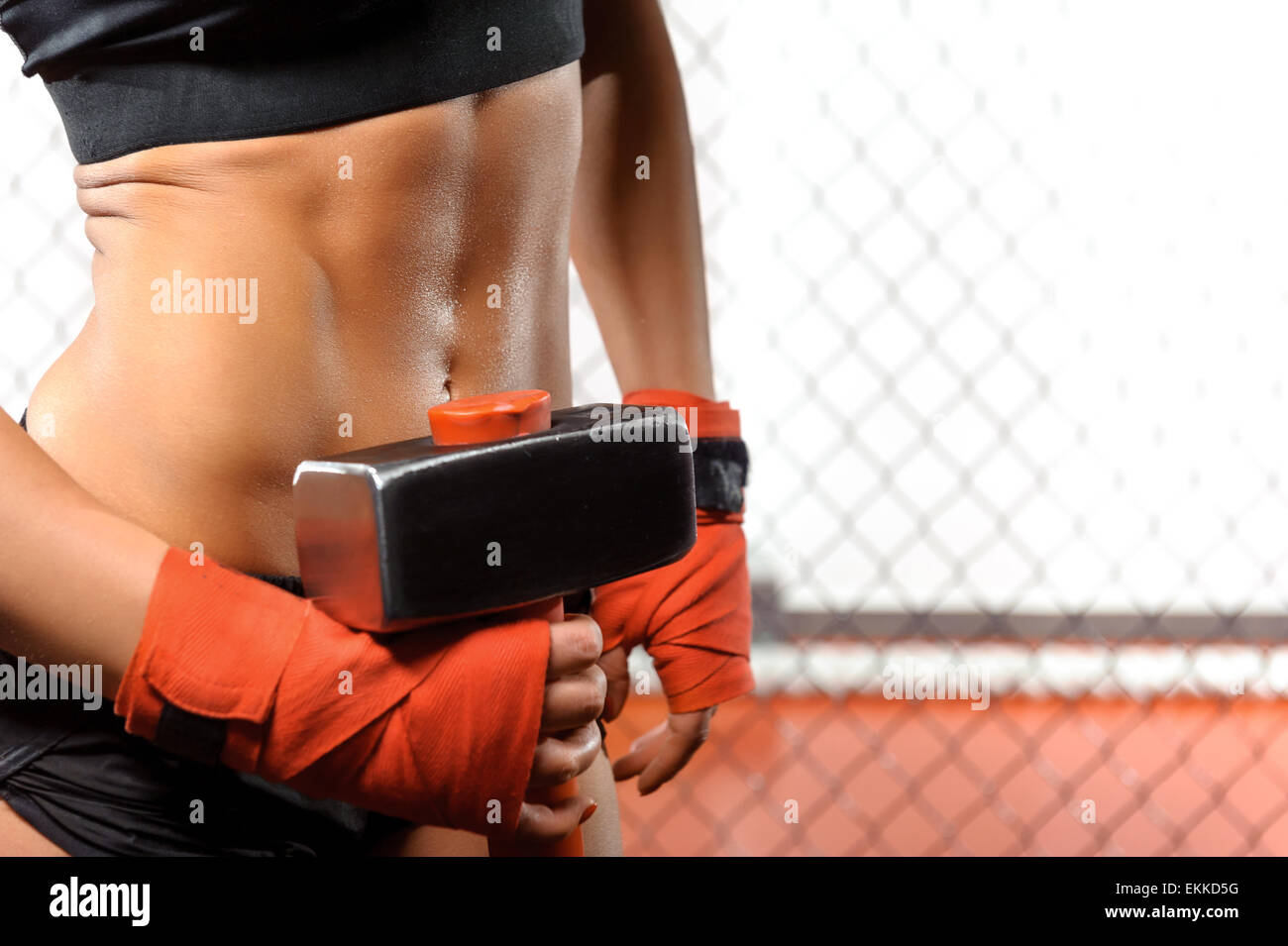 Sportswoman with a hummer in gym - Stock Image
