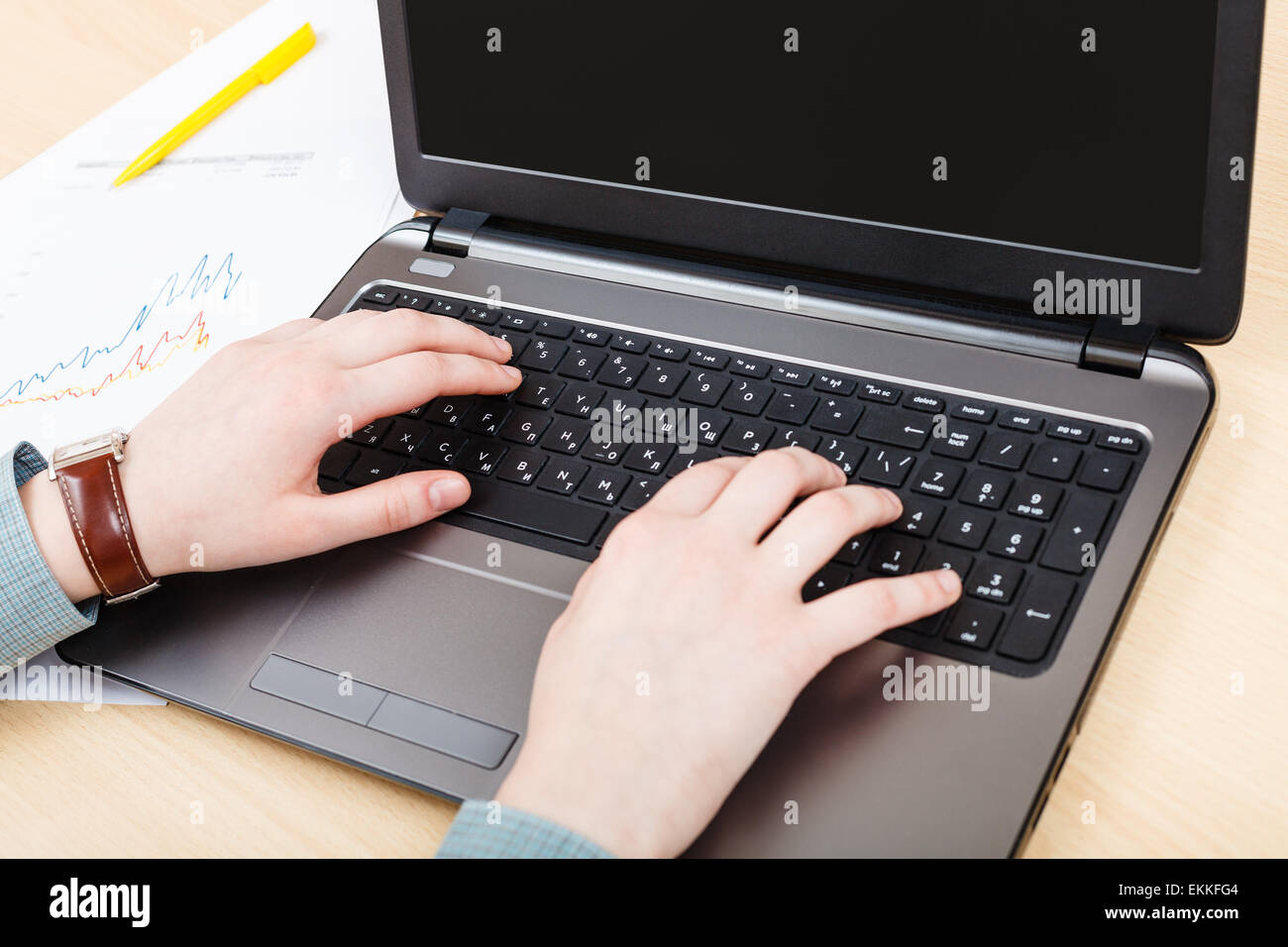 business workflow - working with laptop at office desk - Stock Image