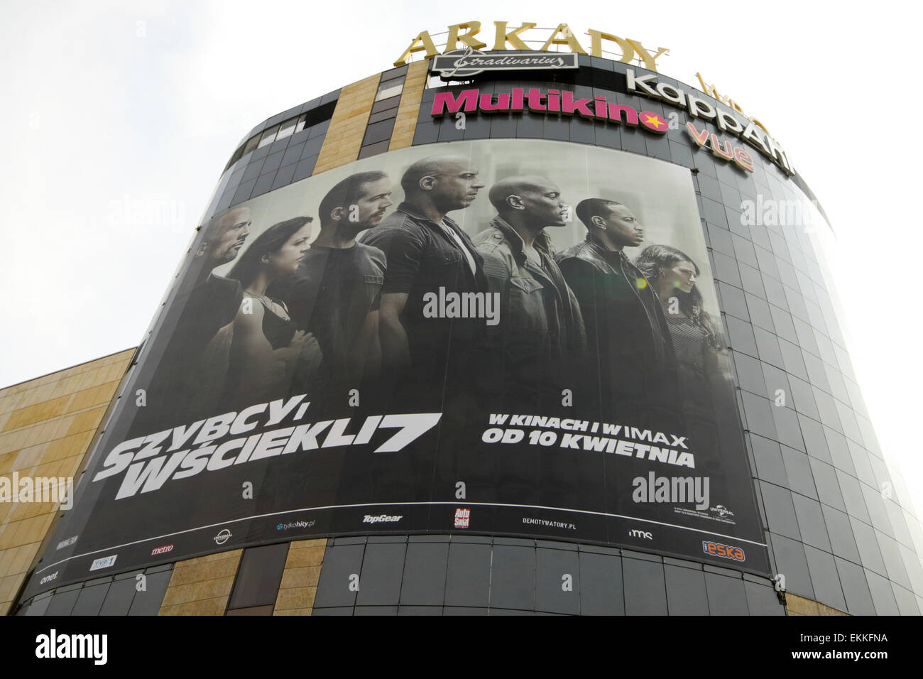 Wroclaw, Poland. 11th April, 2015. Big poster advertising 'Fast and Furious 7' movie on facade of Arkady - Stock Image