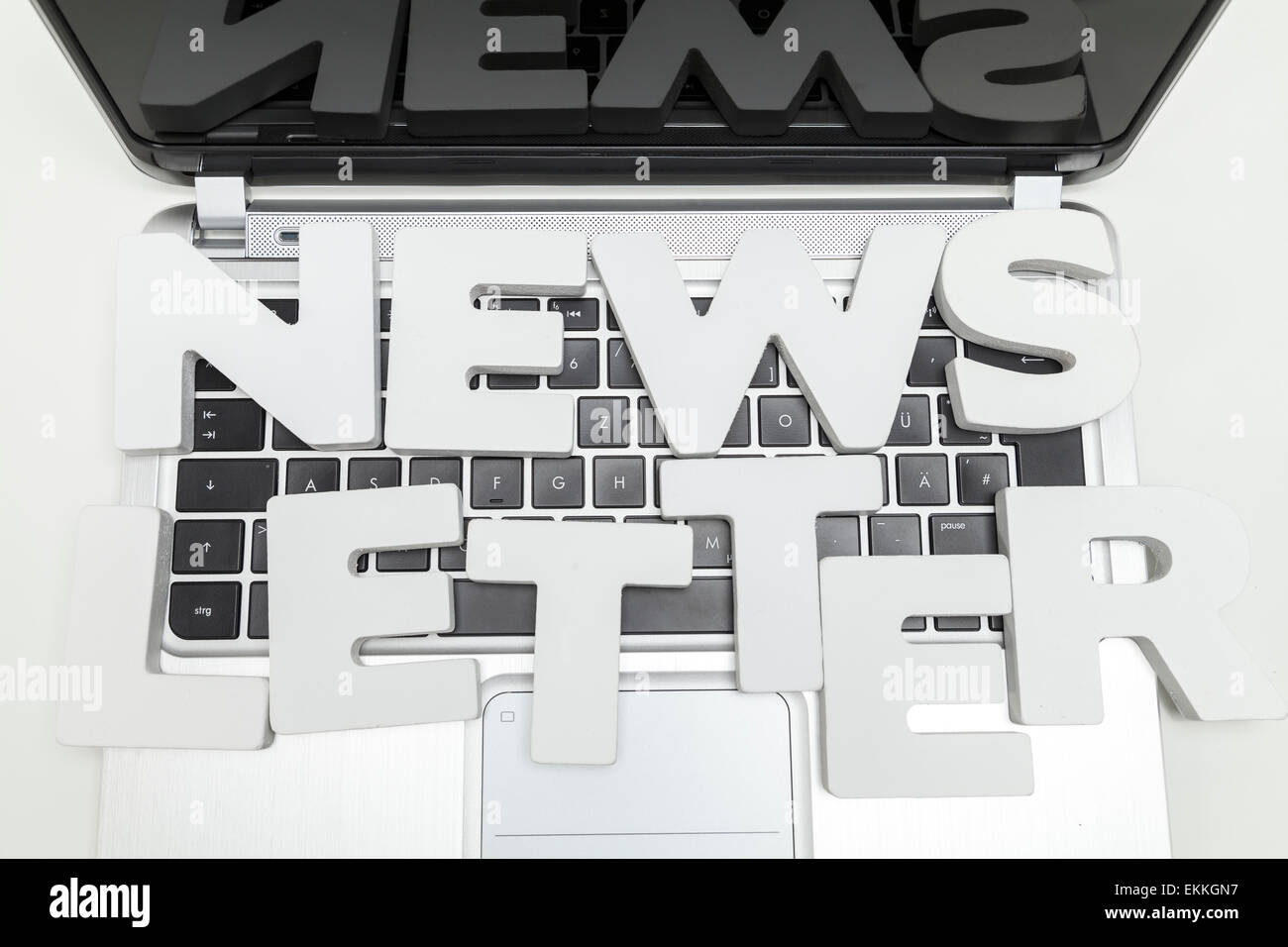 newsletter letters on keyboard of laptop - Stock Image