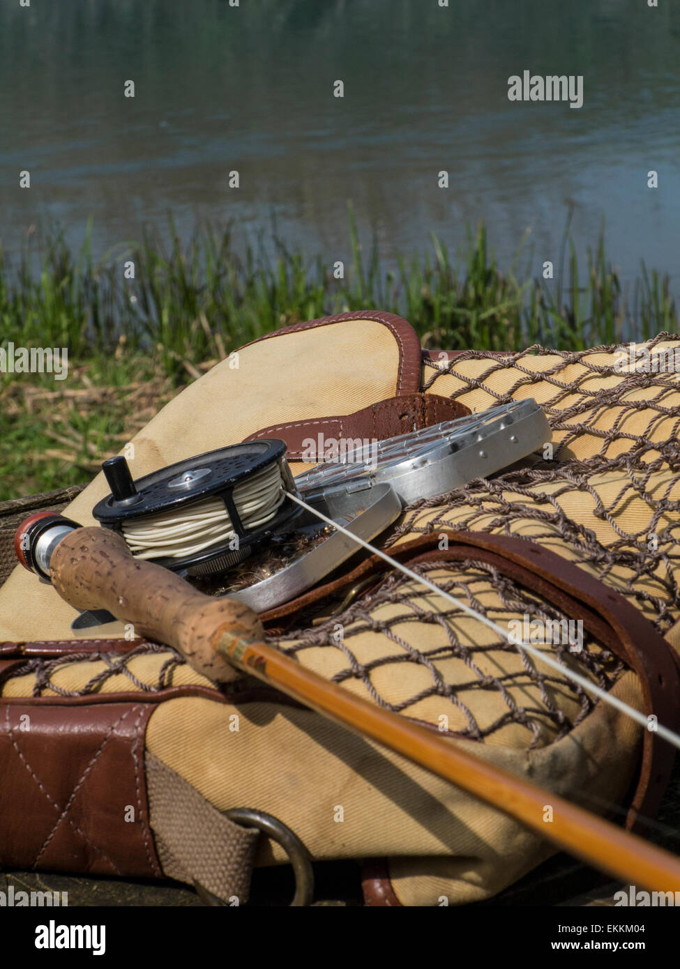 Traditional old vintage fly fishing tackle with the river ...