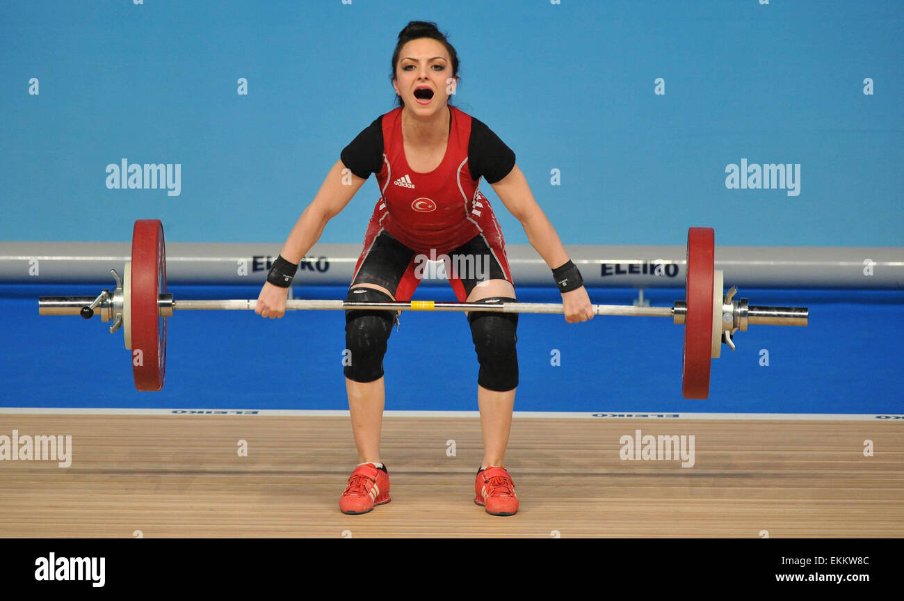 Tbilisi, Georgia. 11th Apr, 2015. Sibel Ozkan of Turkey competes during the women's 48kg clean and jerk final - Stock Image