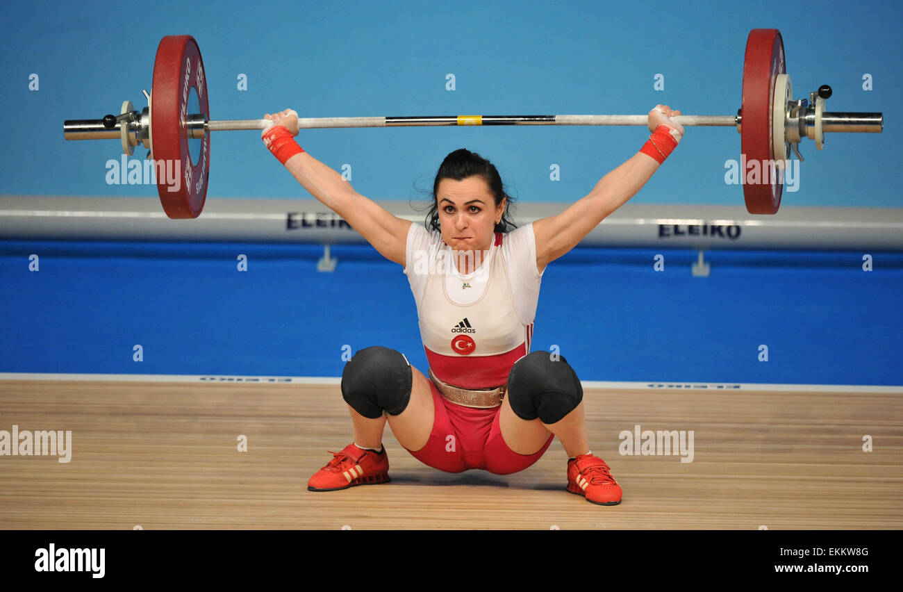 Tbilisi, Georgia. 11th Apr, 2015. Nurcan Taylan of Turkey competes during the women's 48kg clean and jerk final - Stock Image