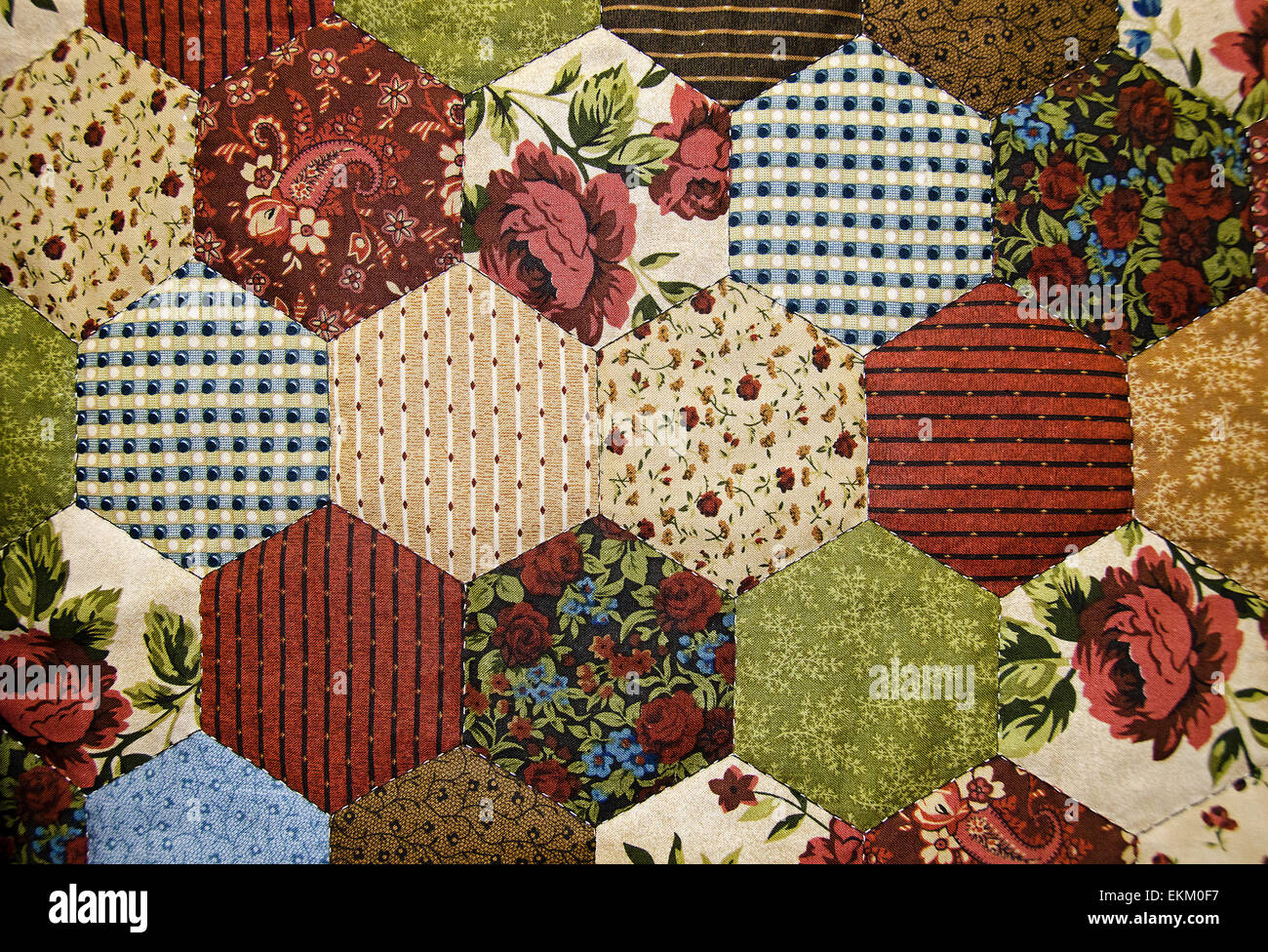 Close up of a hexagon patchwork quilt. - Stock Image