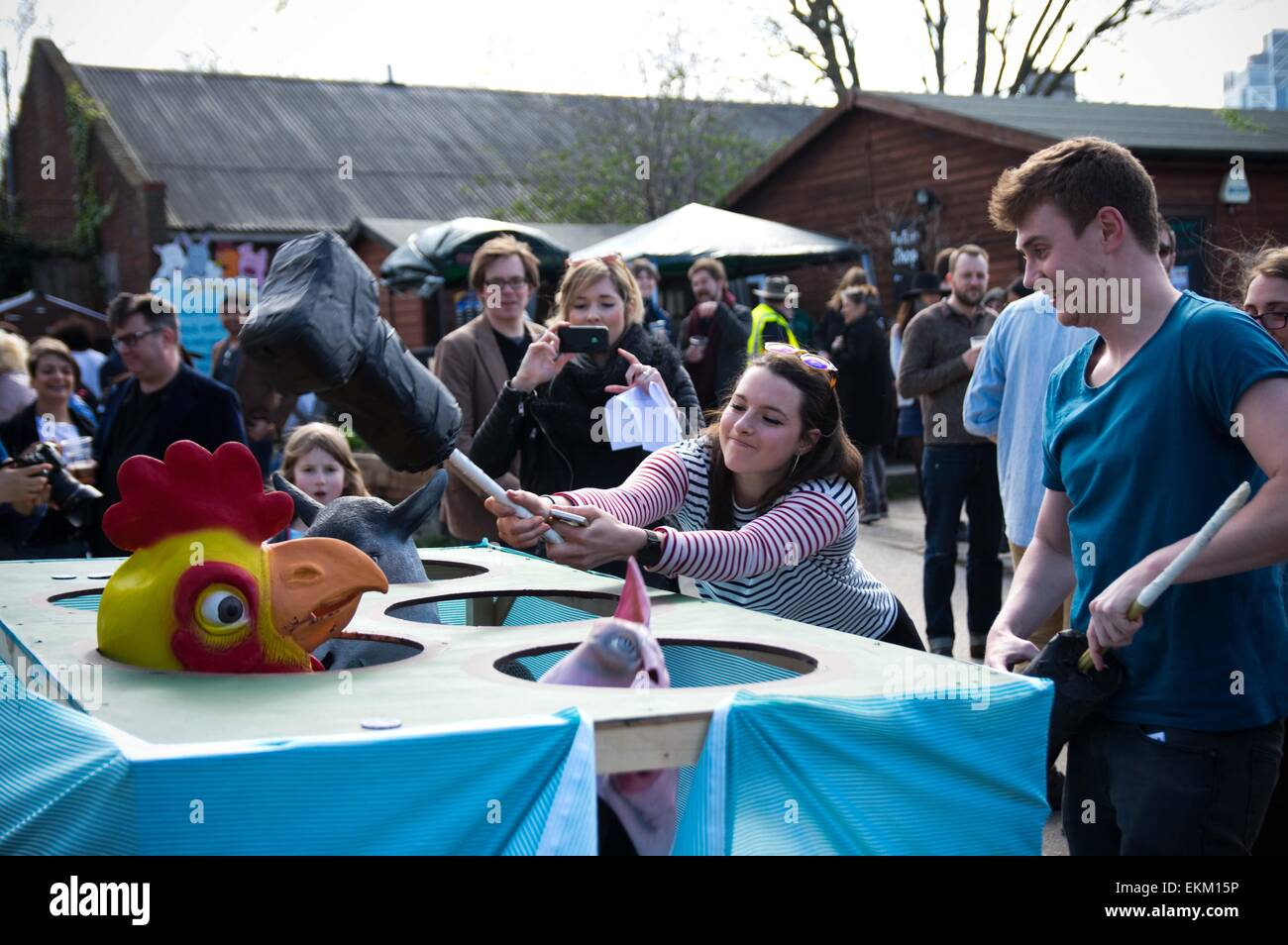 London, United Kingdom. 11th Apr, 2015. Spectators enjoy some games hosted by the venue before the goat race. Annual - Stock Image