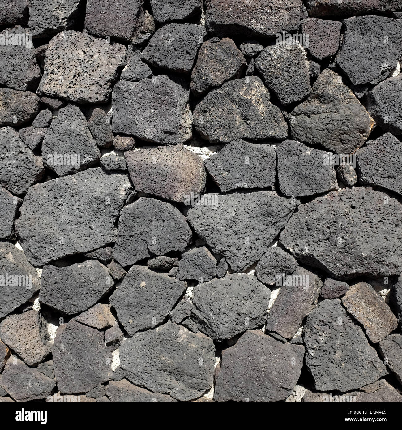 Stone wall made from volcanic rock in Lanzarote - Stock Image