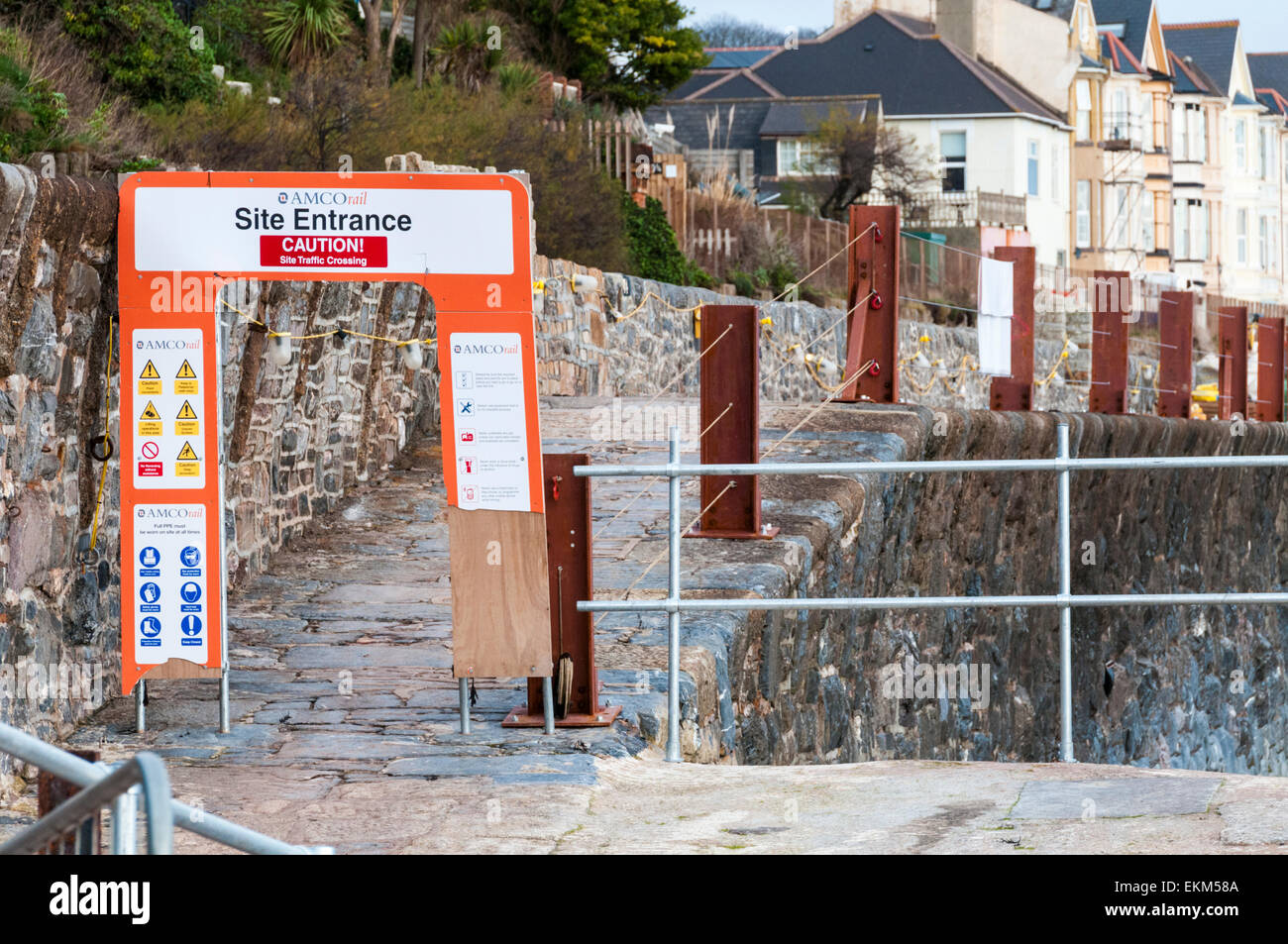 Site entrance to a construction site on Dawlish seawall in Devon - Stock Image