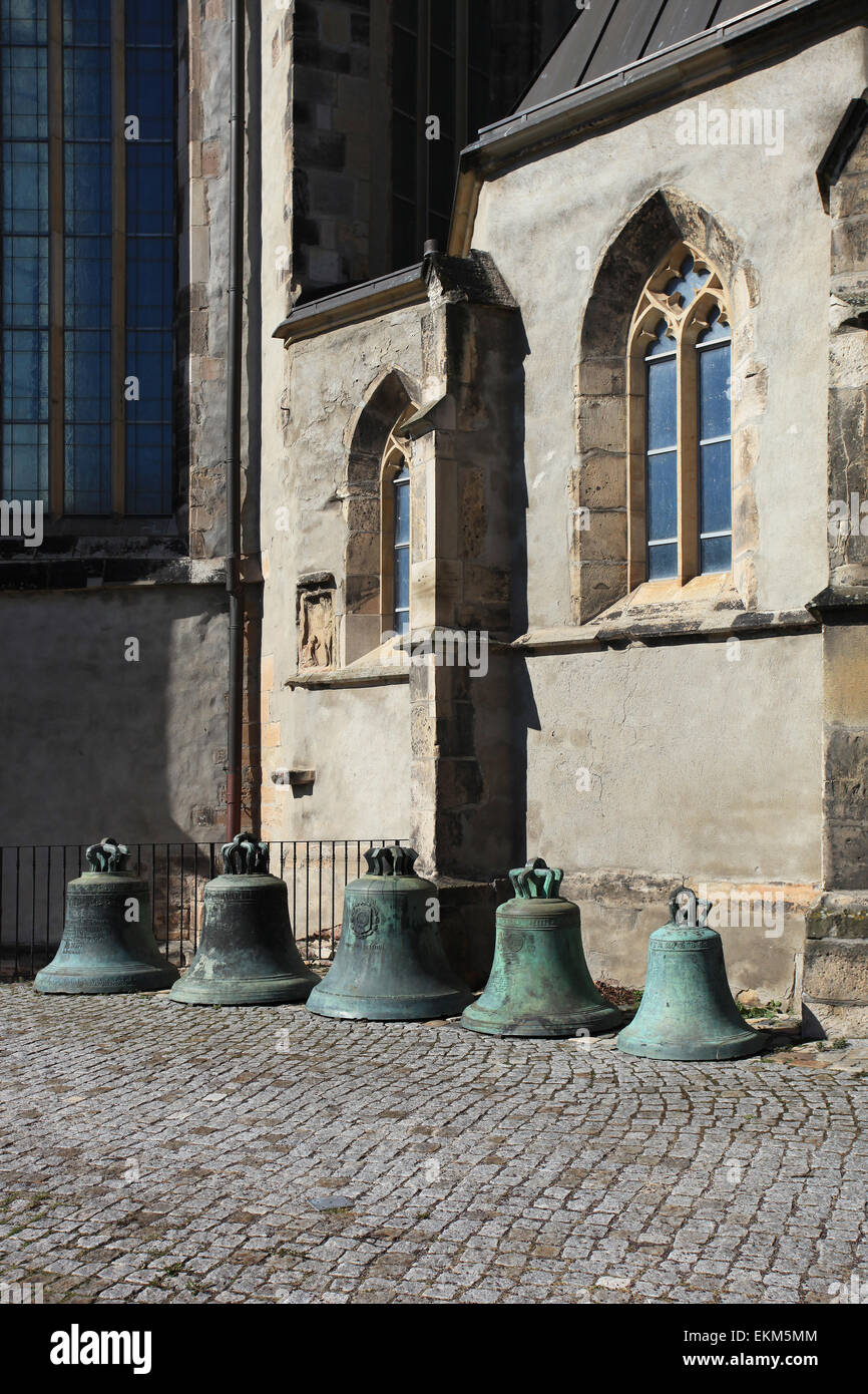 Exhibited church bells in front of the east side of the St. John's Church (St.-Johannis-Kirche). Magdeburg, - Stock Image