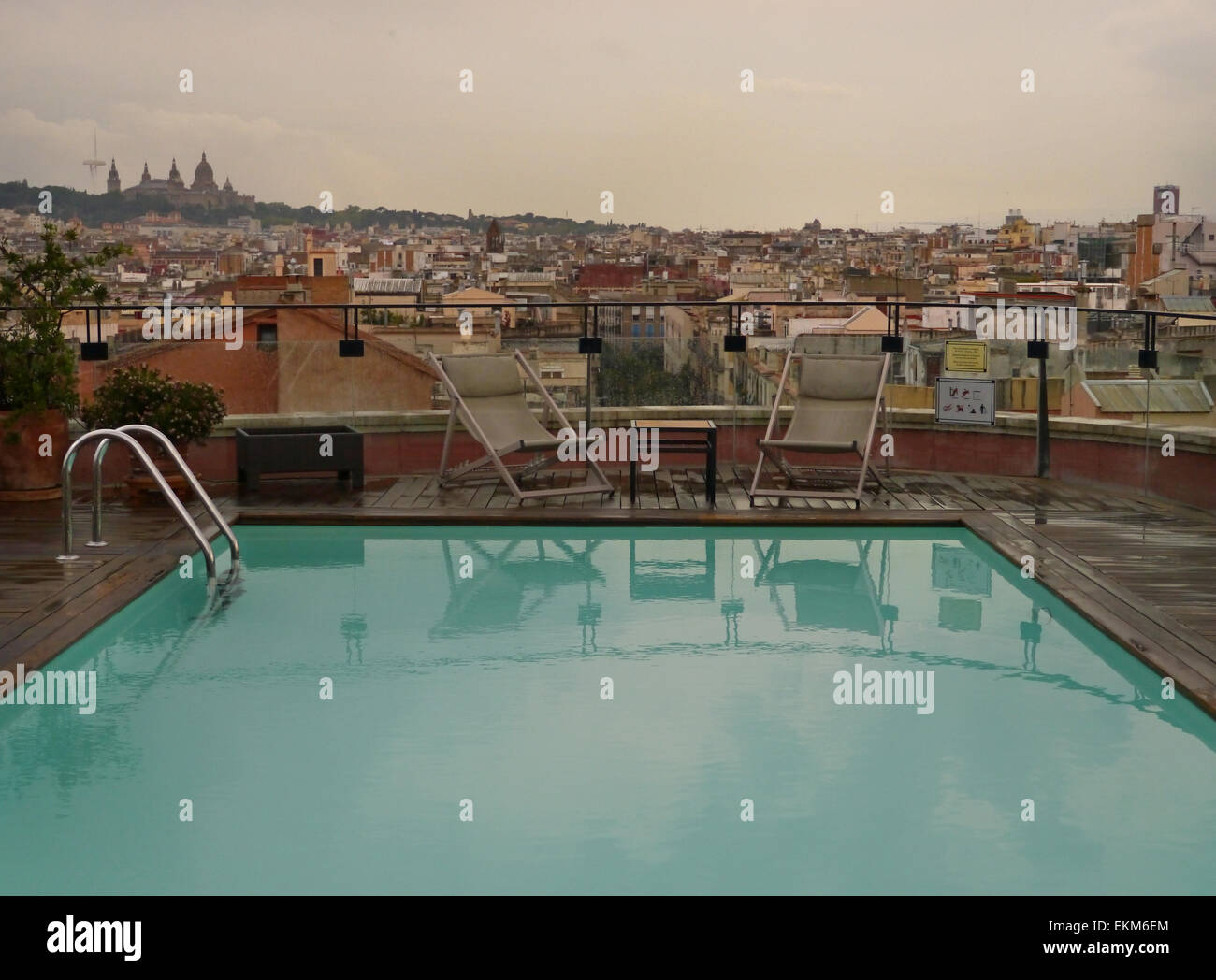 Rooftop swimming pool of the Hotel 1898 in Barcelona, on a rainy day. - Stock Image