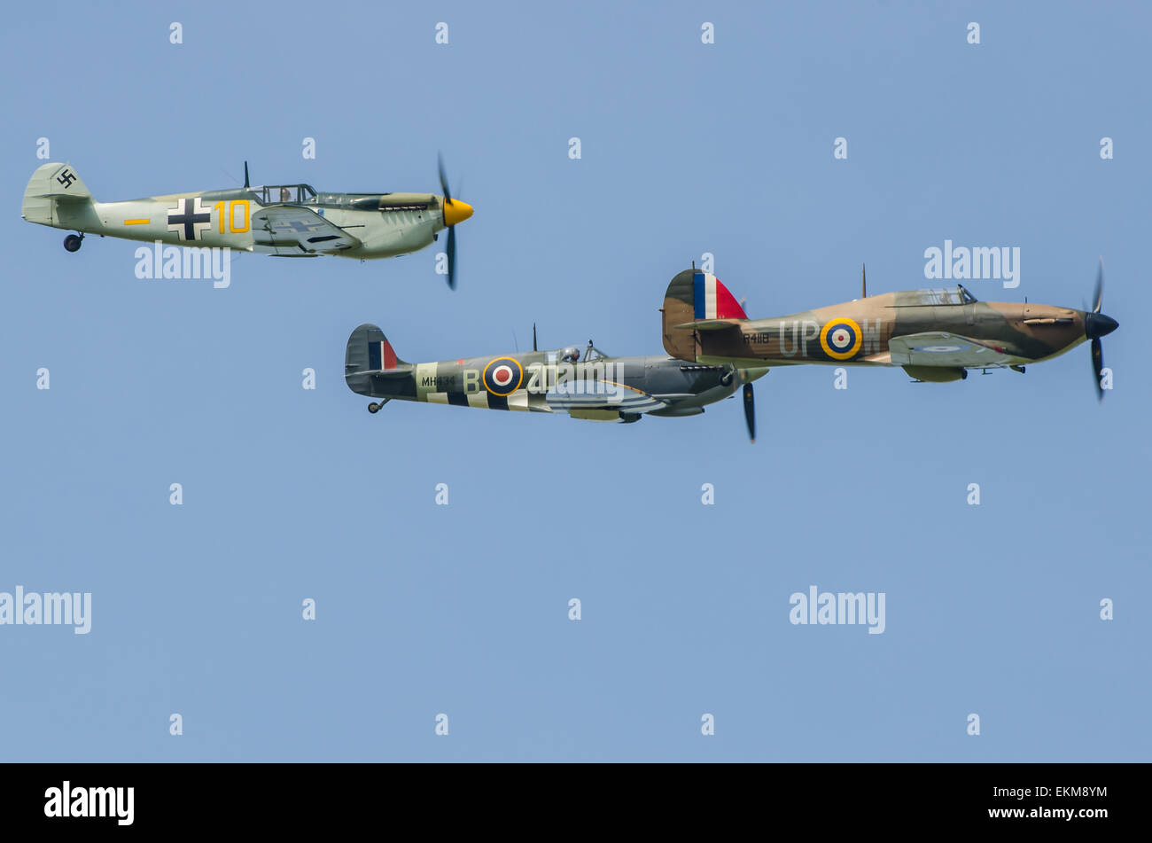 'Messershmitt Bf109' (actually a Buchon - see description) Spitfire and Hurricane in formation at an airshow. - Stock Image
