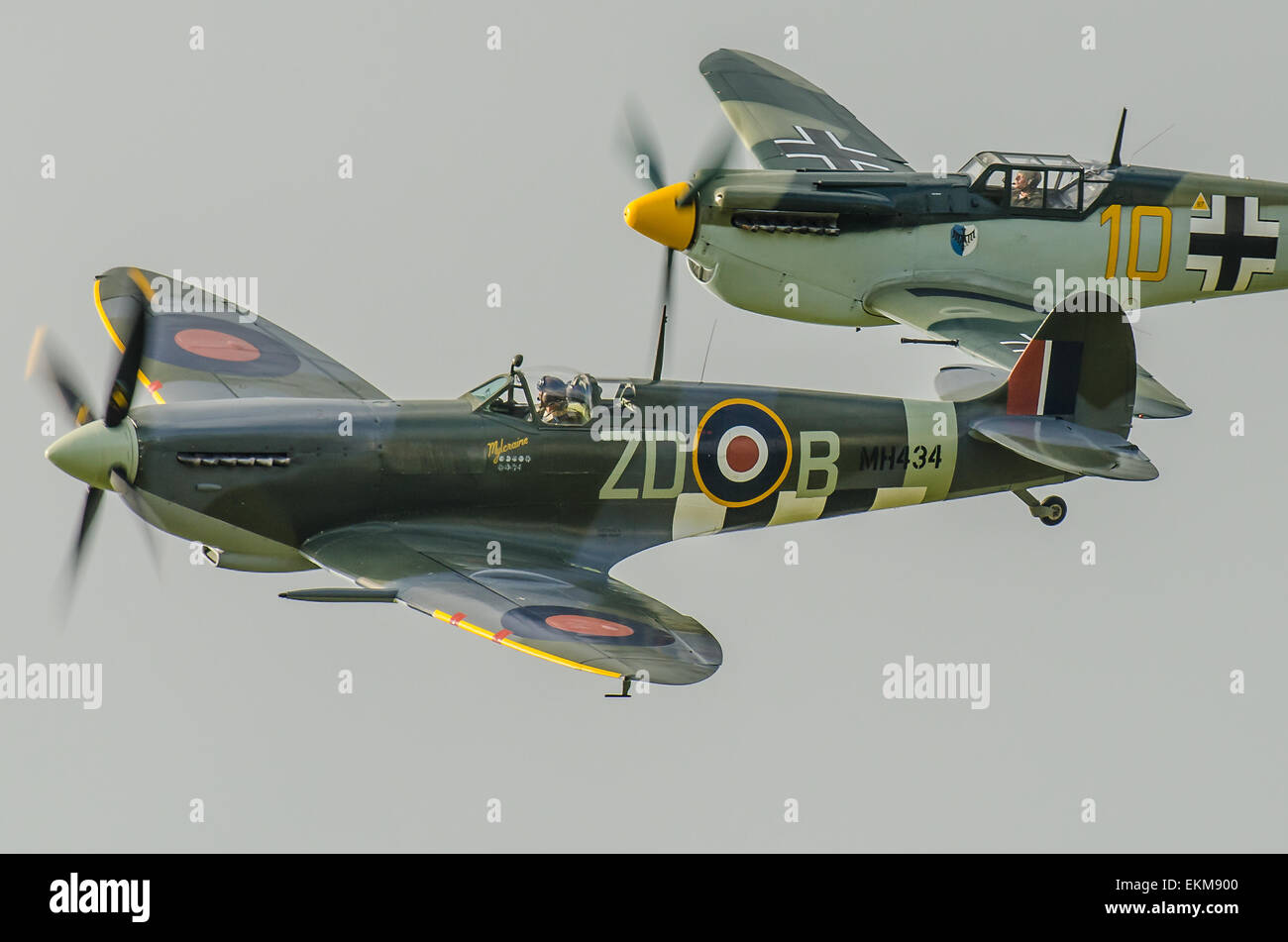 Spitfire MH434 and German Luftwaffe marked 'Buchon'. With few real Bf109s extant a slightly greater handful - Stock Image