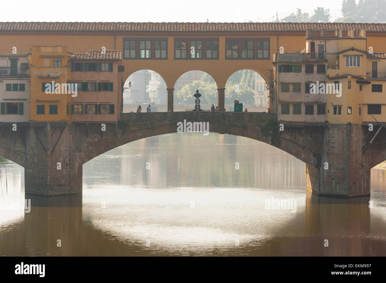 Florence bridge, view of the Ponte Vecchio in Florence back-lit by the early morning sun, Tuscany, Italy. Stock Photo
