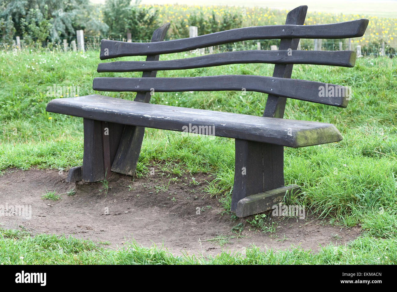 Empty bench in a park in Wismar, Germany - Stock Image
