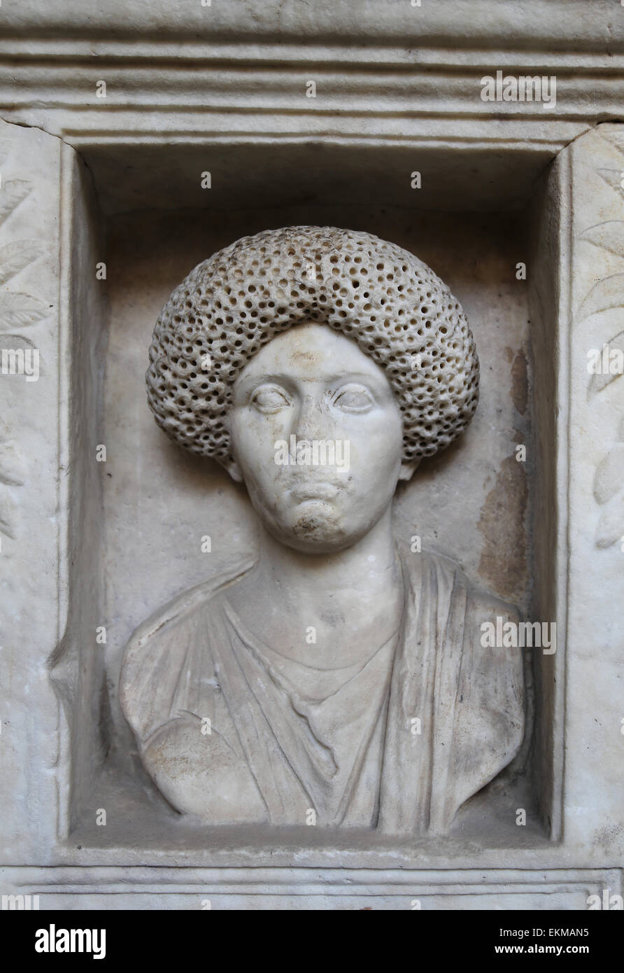 Roman tombstone. Marble. Relief. Female portrait. Vatican Museums. - Stock Image