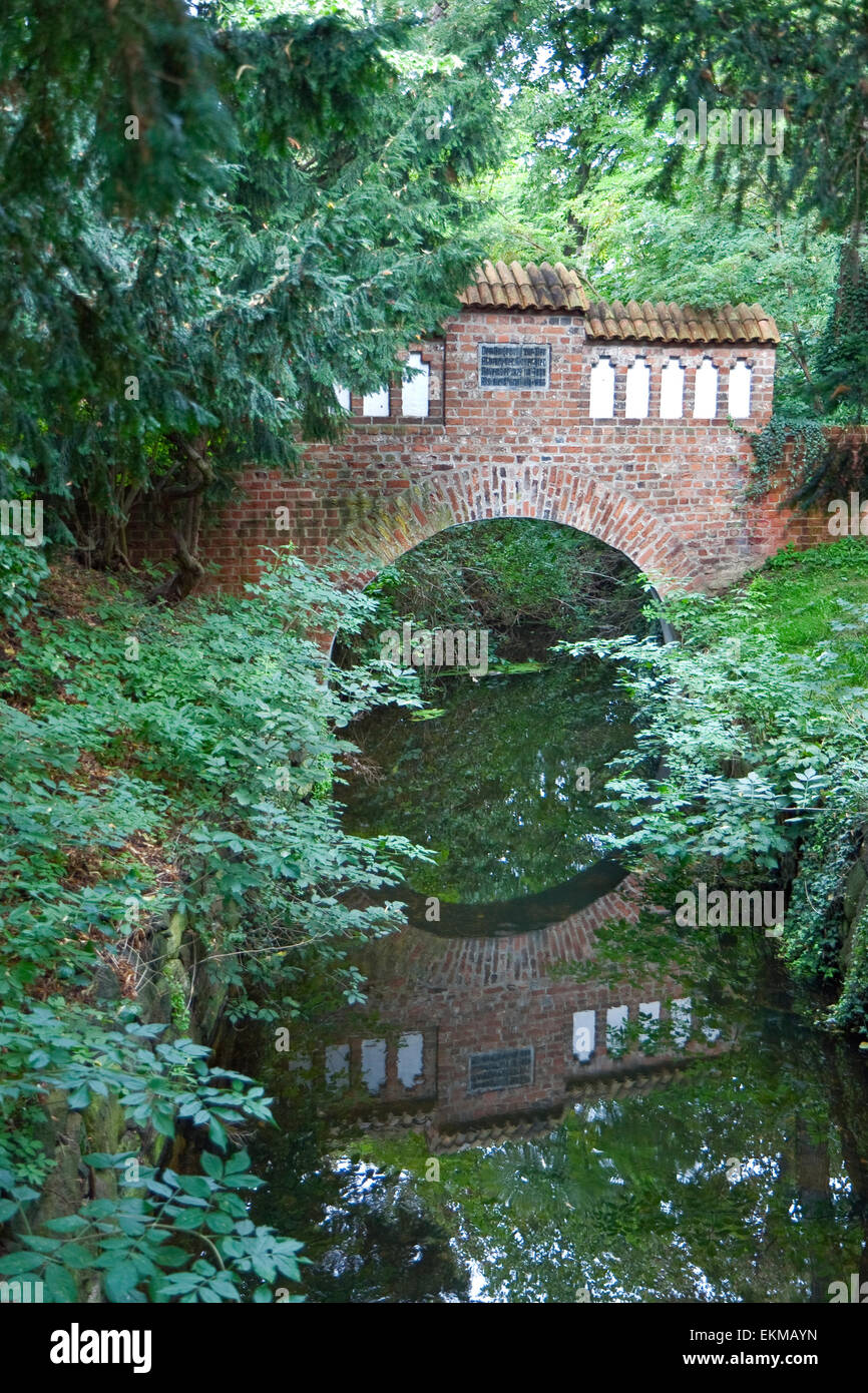 Old bridge made of bricks over a small canal at Wismar, Germany - Stock Image