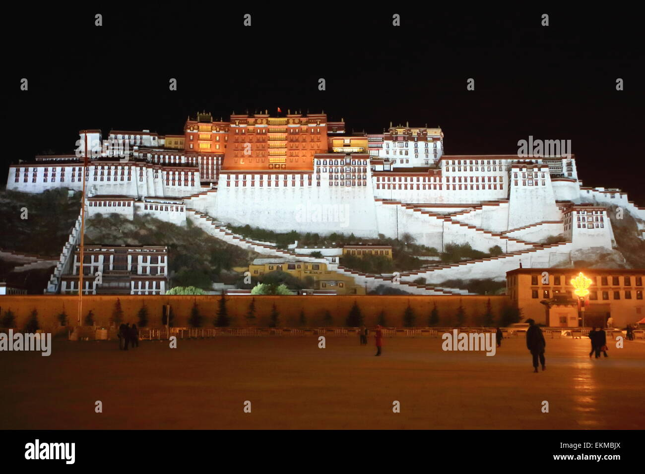 Potala palace and square at night with the Potrang Karpo-White Palace to the East and the Potrang Marpo-Red Palace - Stock Image
