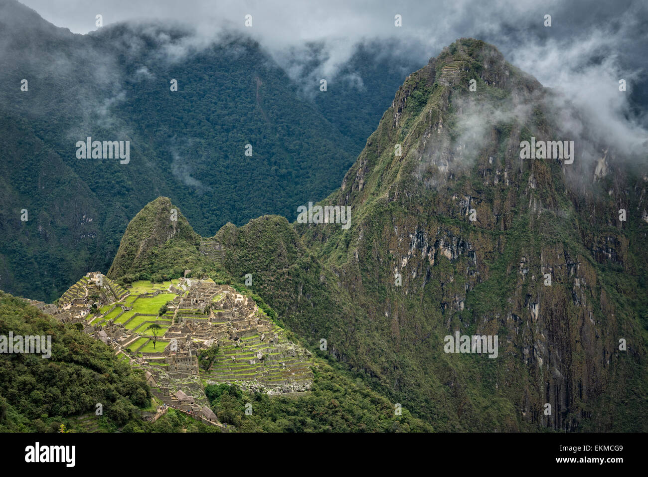 Machu Picchu and Huayna Picchu Peak from the Inca Trail below Sun Gate; Machu Picchu, Peru. - Stock Image