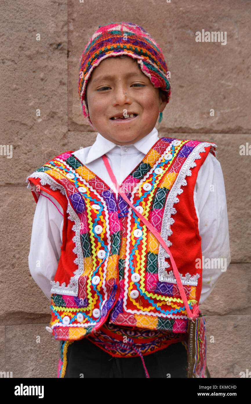 Quechua boy wearing traditional clothing of the region; Moray Village, Sacred Valley, Peru. - Stock Image