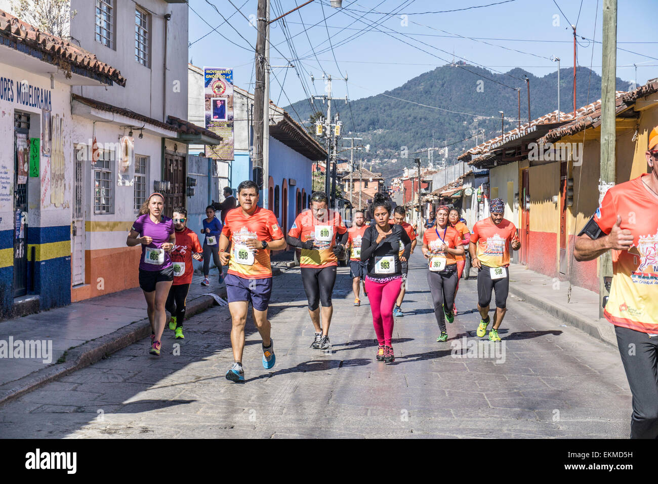 determined group of bunched runners running San Cristobal de las Casas half marathon which draws runners from surrounding - Stock Image