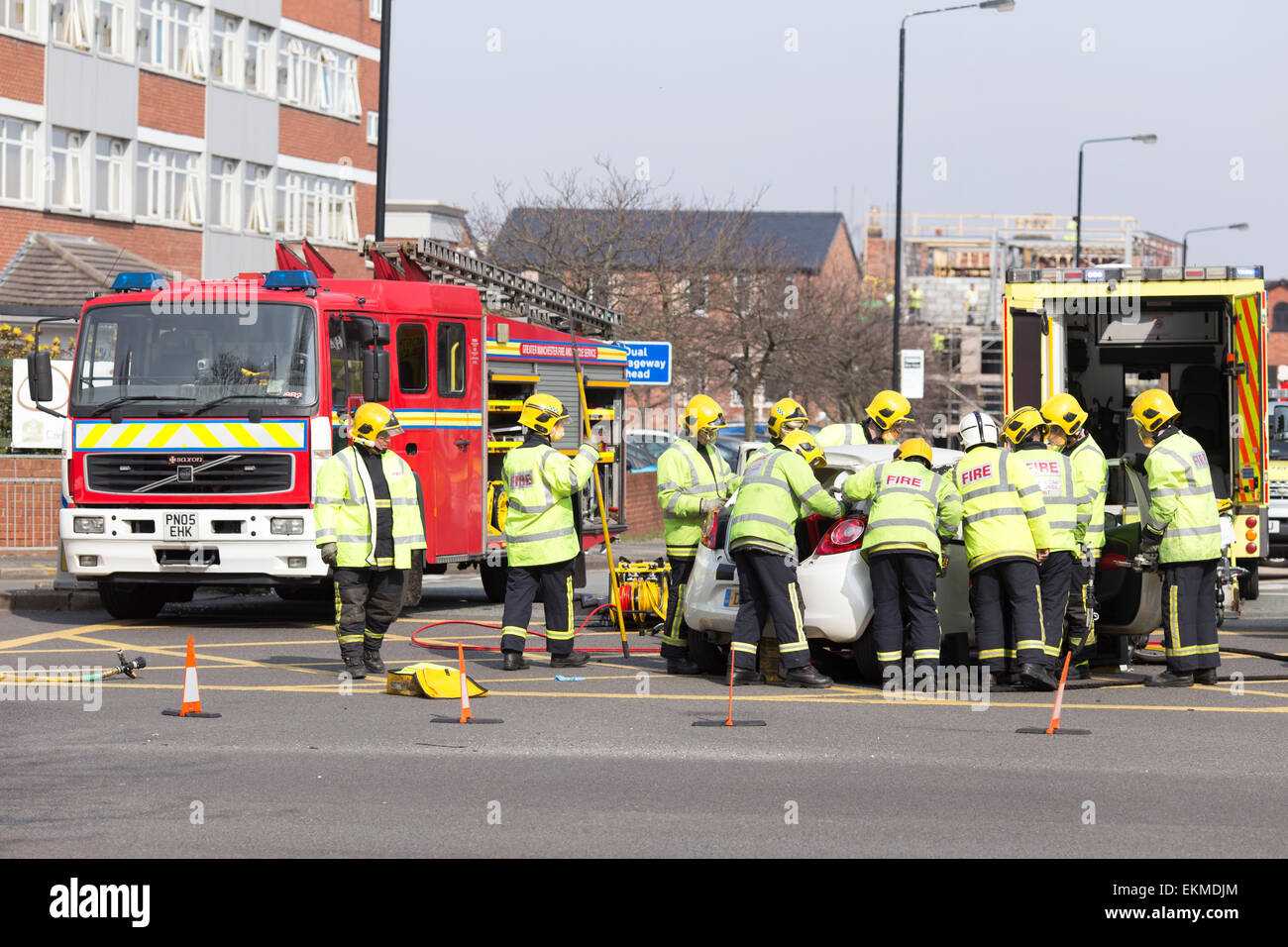 Chris Bull . WED 8-4-15. ALTRINCHAM  , Fire and ambulance crews attend a crash between a Ford Ka and a Range Rover - Stock Image