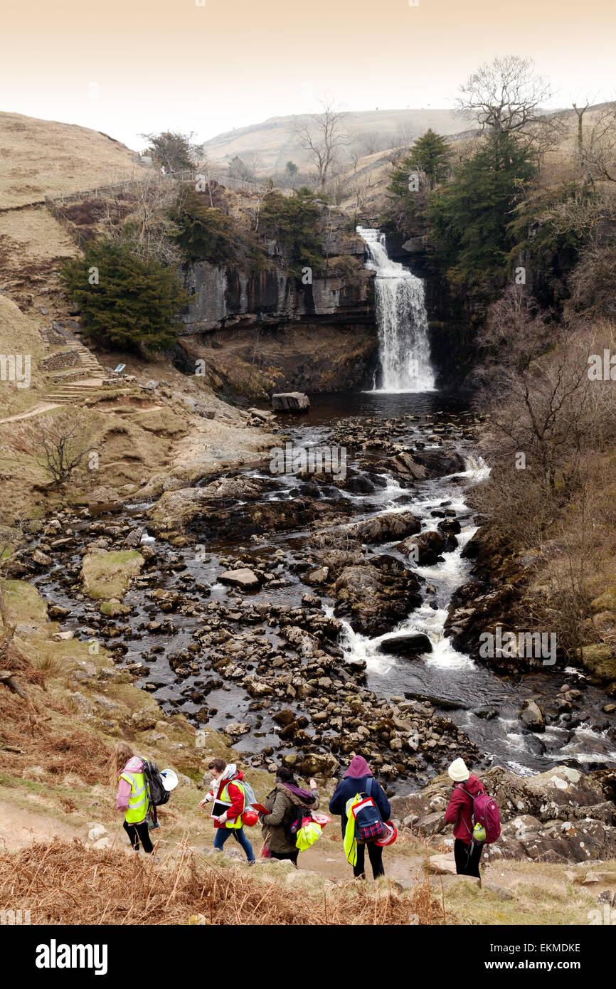 Teenagers doing their Duke of Edinburgh Award at Thornton Force waterfall, River Twiss, Yorkshire Dales, England - Stock Image