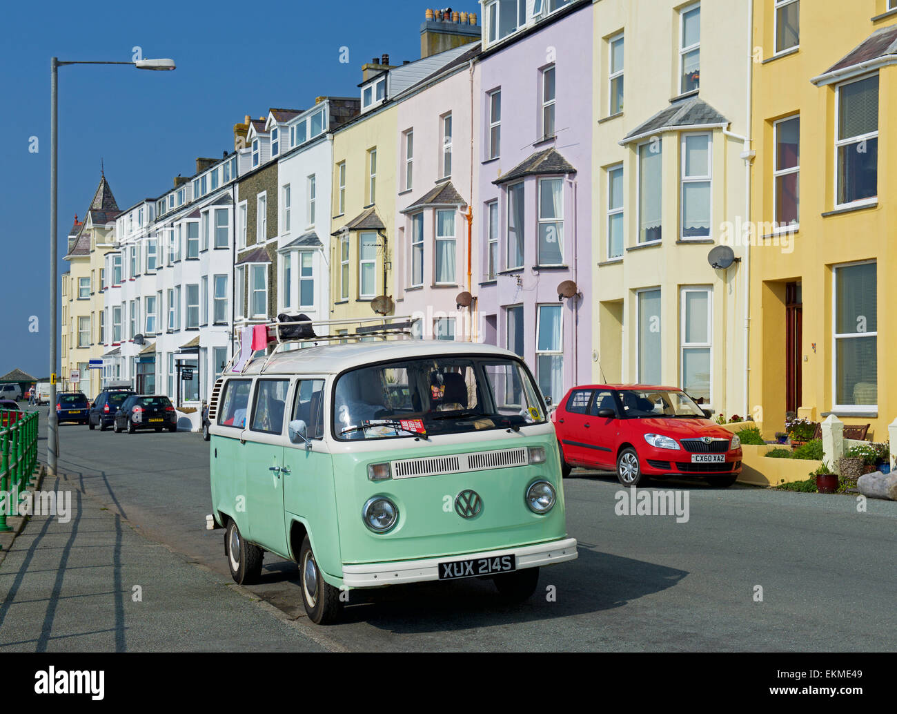 VW campervan parked in front of hotels in Tenby, Pembrokeshire, Wales UK - Stock Image