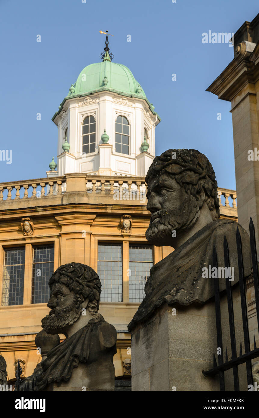 A view of the Sheldonian Theatre with the stone heads of the Roman Emperor's in front. Part of the University of Stock Photo