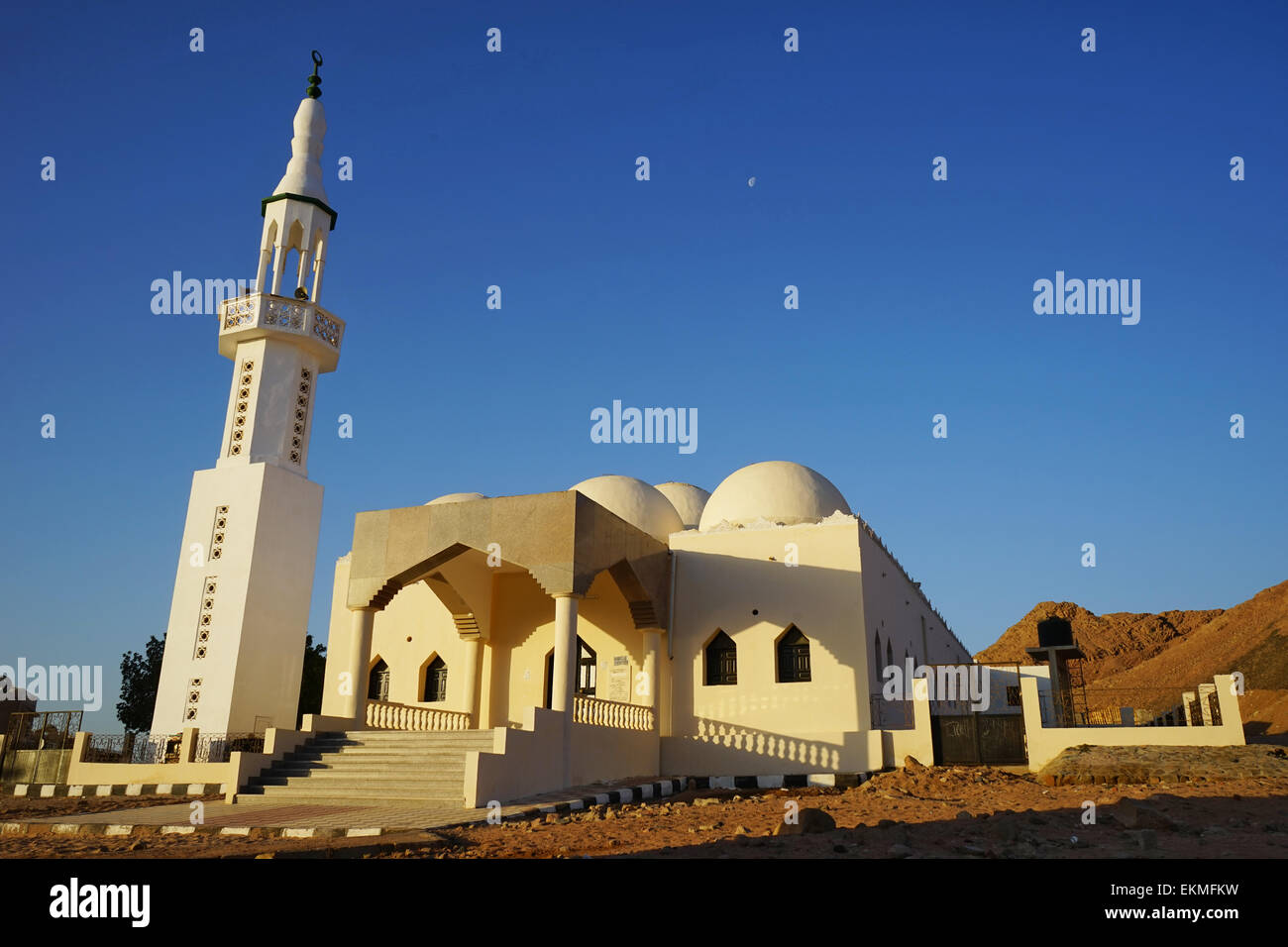 Mosque  in mountains .Sunrise and  moon .Dahab. South Sinai. Egypt . - Stock Image