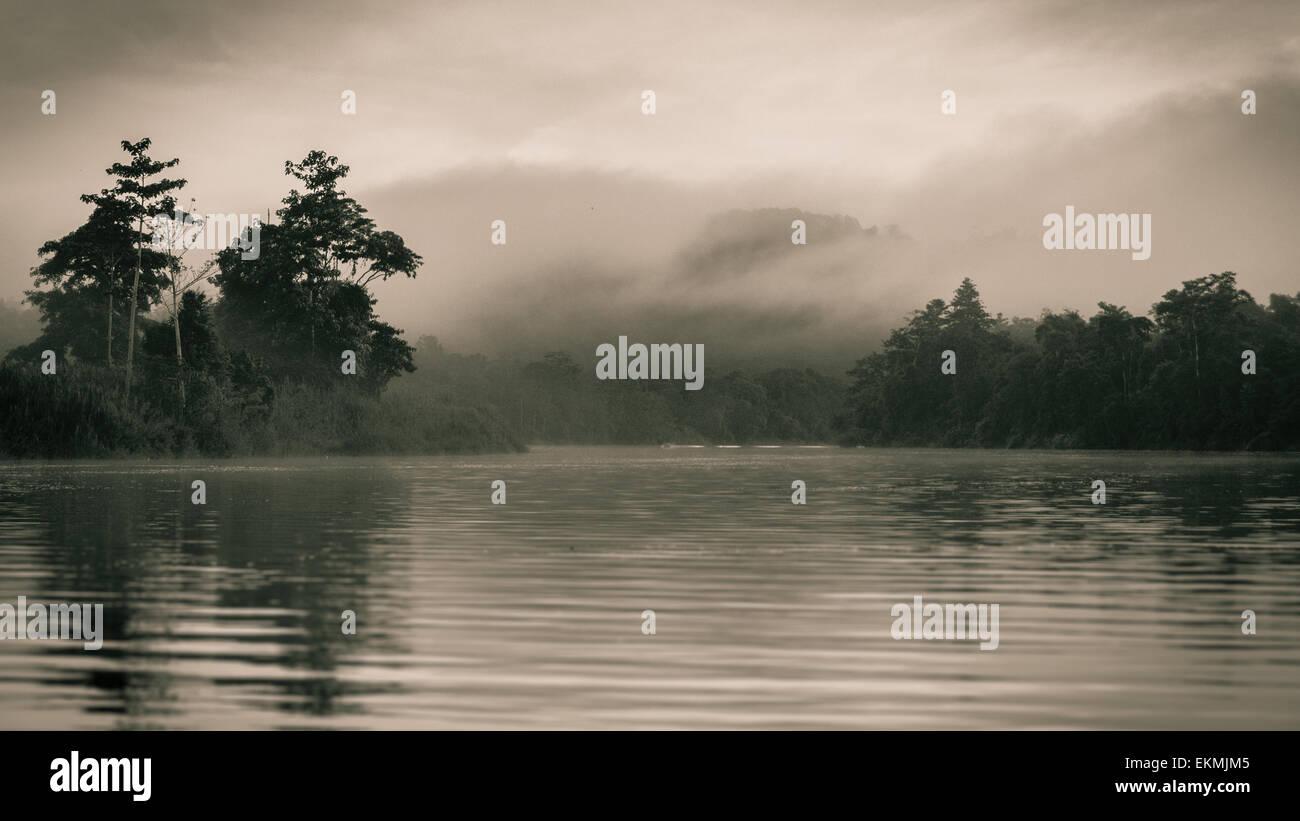Foggy morning on the Kinabatangan river, Borneo, Malaysia Stock Photo