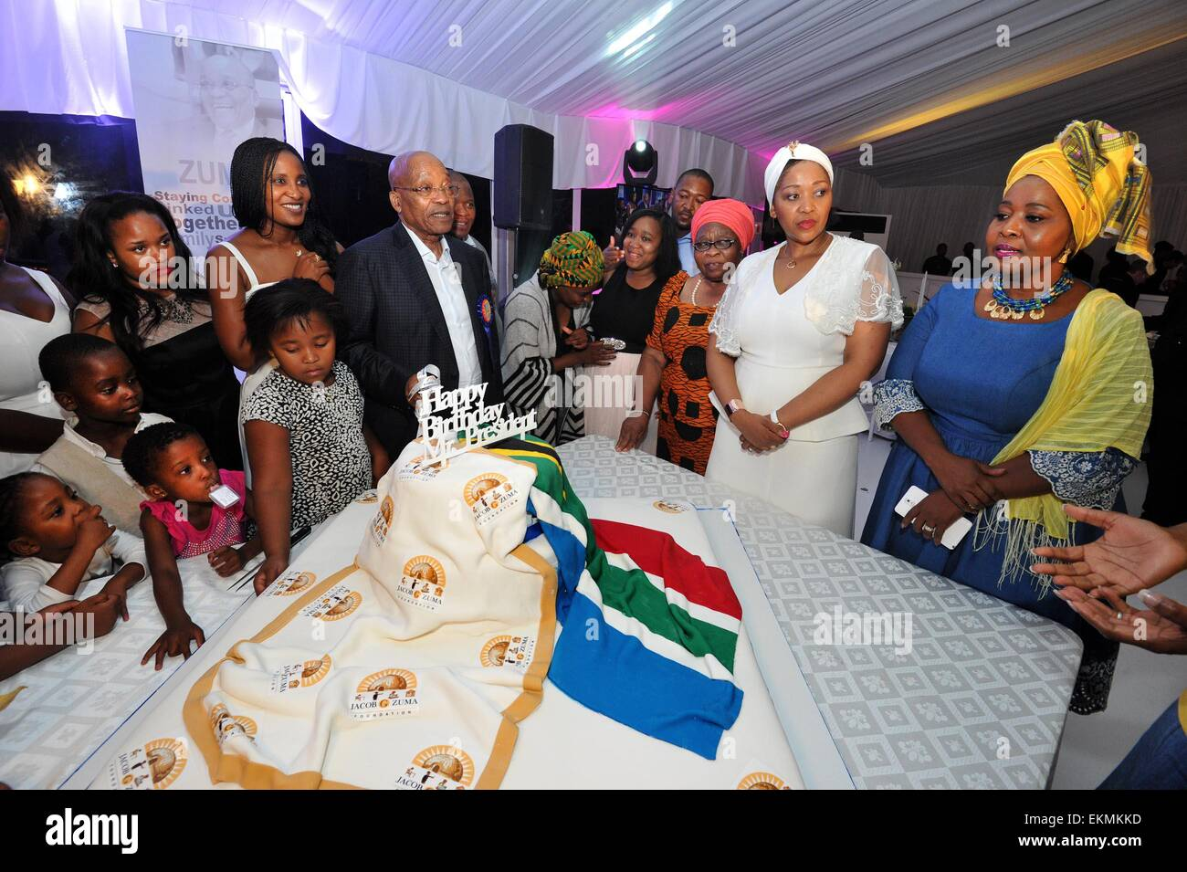 Durban, South Africa. 12th Apr, 2015. South Africa's President Jacob Zuma (C) tries to cut the birthday cake - Stock Image