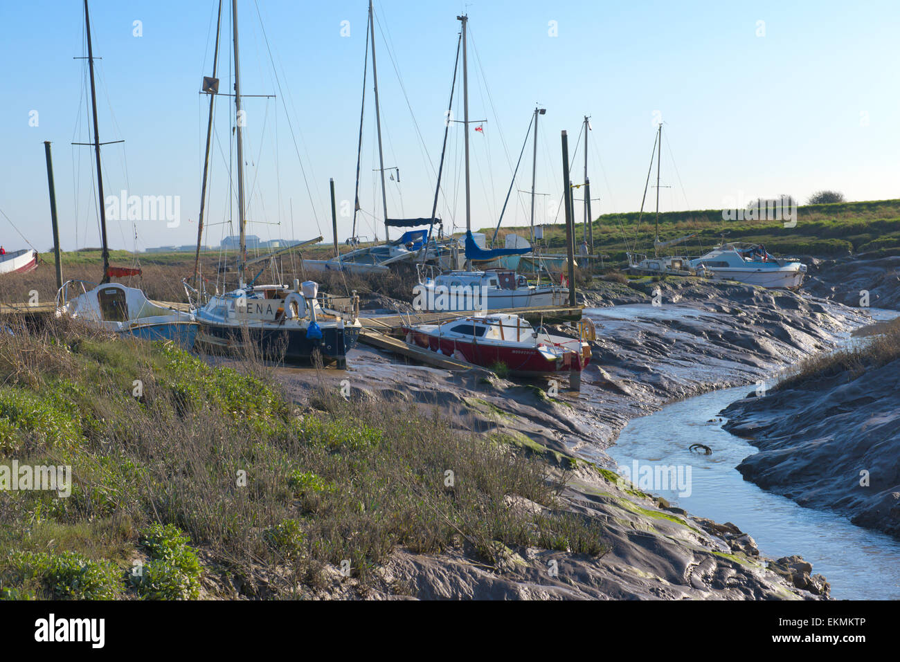 Boats on mud at low tide on river Axe at Uphill boat yard near Weston-super-Mare North Somerset Stock Photo
