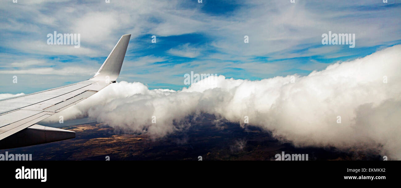 View of airplane wing from inside the airplane cabin. - Stock Image